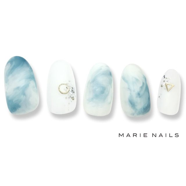 Mesmerized light blue and white nails
