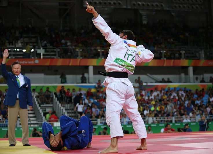 Rio Olympics: Highs and lows from day four:      Aiming high:    Italian judoka Matteo Marconcini points at the sky after he defeats Valeriu Duminica of Moldova during the Men's Judo 81 kg elimination round.