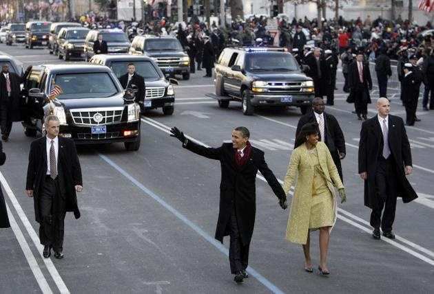 President barack obama walks down pennsylvania avenue with for First president to be inaugurated on january 20