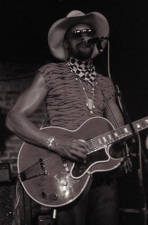 Taj Mahal - my favorite blues artist because his songs have a sweetness that is completely unique. I got to meet him, and his hands are bigger than my head.