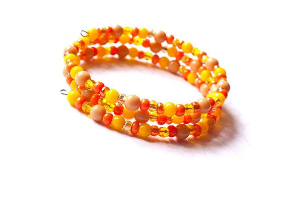 Yellow and orange memory wire bracelet in boho style