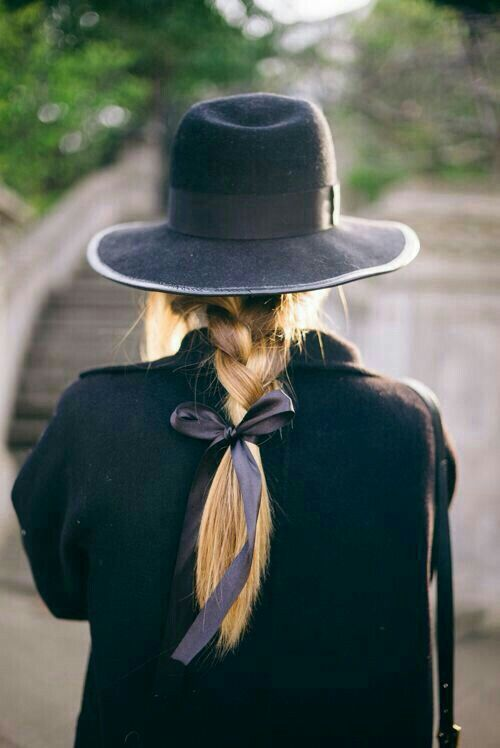 paris. outfit styling. Braid tied with black ribbon, black felt hat, all black everything