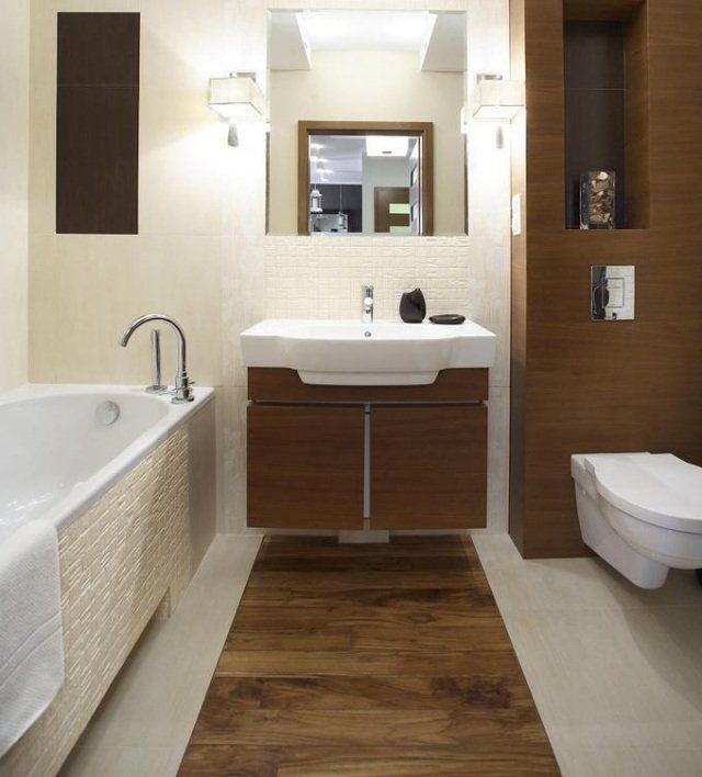 carrelage de sol et mural d'aspect bois dans la petite salle de bains