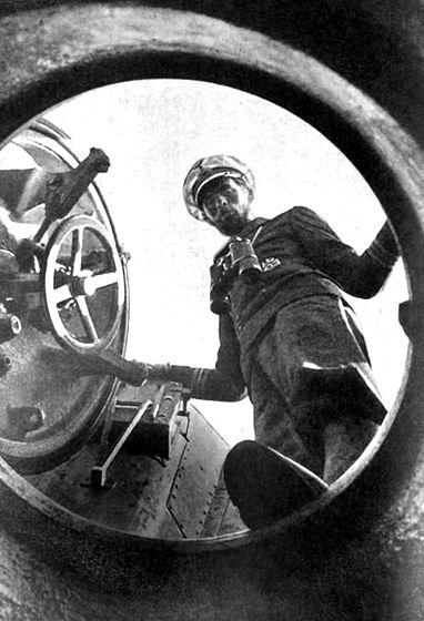 A German U-Boat commander staring down the hatch.