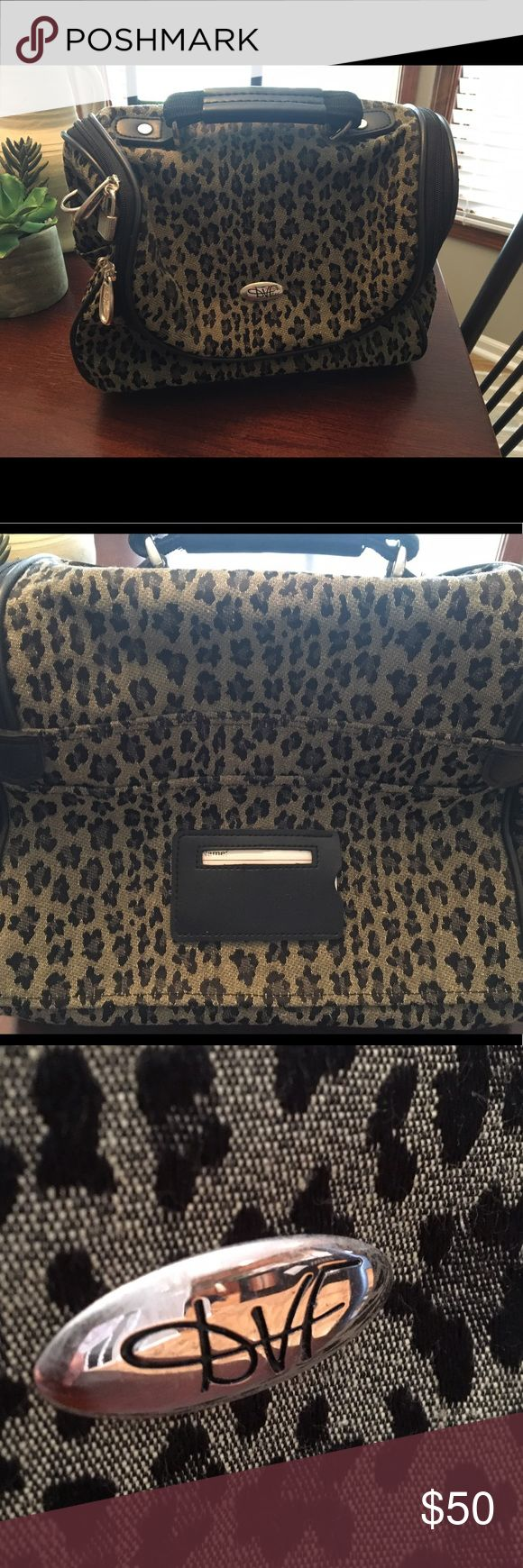 DVF Travel/cosmetic bag 💼 Colors are gray/black with animal print. Zipper goes all the way around for easy in and out !! Black interior with mirror. Drame Vou Furstenberg . Black on bottom with 4 feet. Designed in USA. Made in Thailand. No shoulder strap. DVF Bags Travel Bags