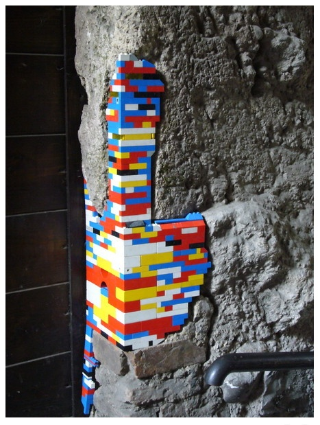 Crumbling brickwork patched up with Lego.