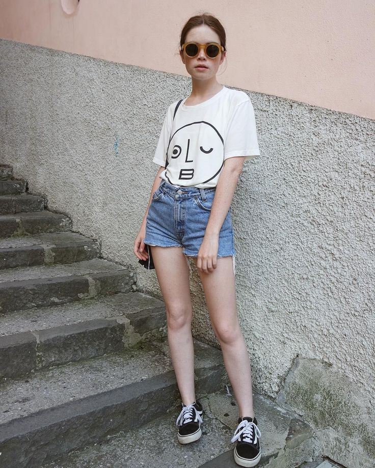 Jean shorts and a white tee are the ultimate summer wardrobe pairing for a reason. Olderbrother top, Vans shoes....