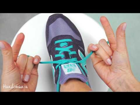 In about 30 seconds, this tutorial shows how to tie your shoes in 2 seconds by making two knots, then threading the laces through and pulling.