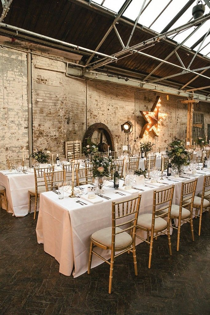 Photo Credit: Kat Hill | Cosy Romantic Urban Winter Warehouse Wedding by London Bride at MC Motors