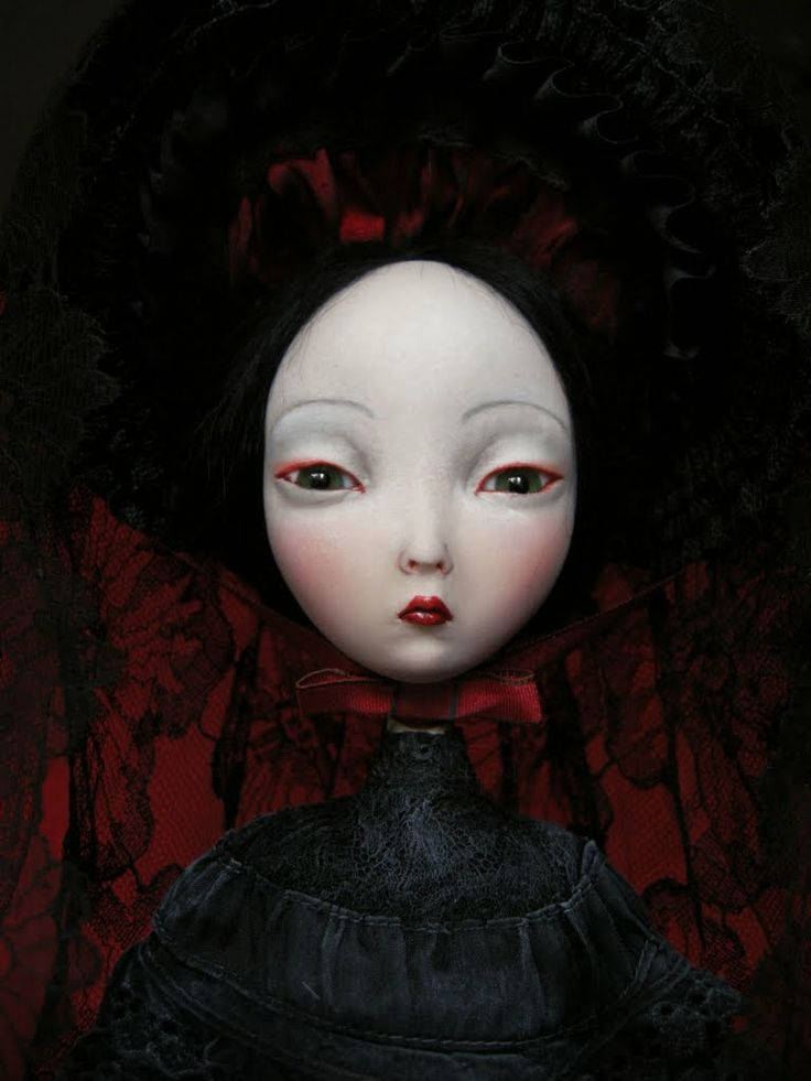 Benjamin Lacombe. I love the beautiful dark nature of this piece. The porcelain doll face and dark themed background work in harmony together. Such an interesting mix making the doll stand out.