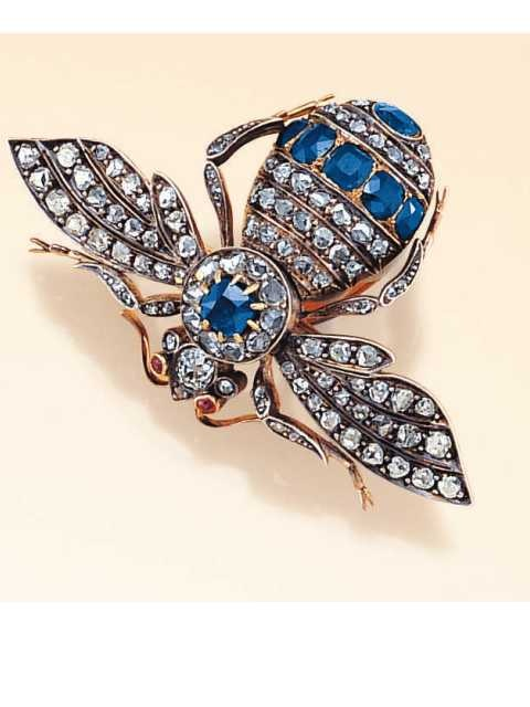 Antique Bee Brooch, circa 1885Body decorated with rose-cut diamonds (a few are chipped) and cushion-shaped, faceted sapphires having a total weight of approx. 2.65 cts., with ruby eyes and an old mine-cut diamond-set head, in silver-topped 18K pink gold.With French hallmarks
