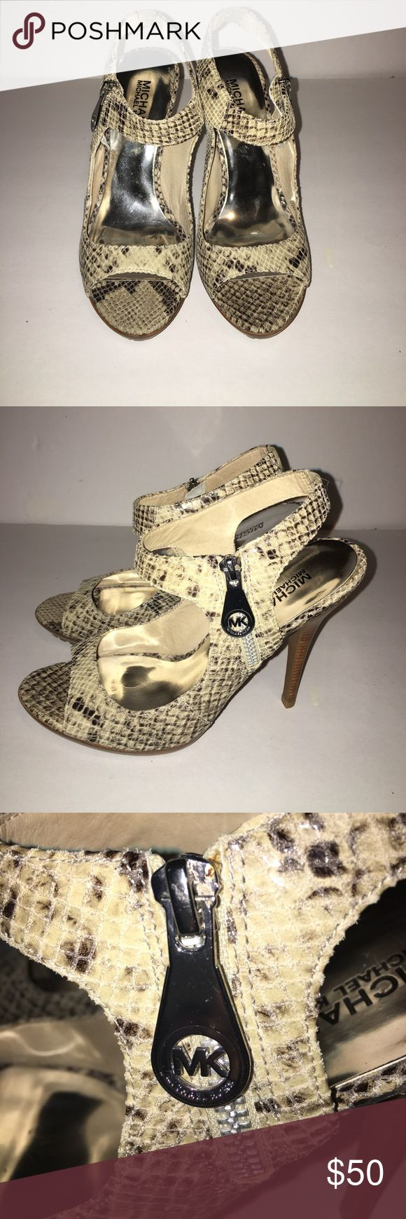MICHAEL Michael Kors Snakeskin Heels Brand: MICHAEL Michael Kors (Like NEW) •Snakeskin Print •Peep toe •Ankle strap •Side zipper Michael Kors Logo  •3 1/2 in heel With a rubber heel and a slight platform. Style with trendy skinny jeans or a little black dress. 🙅🏻NO TRADES🚫 MICHAEL Michael Kors Shoes Heels