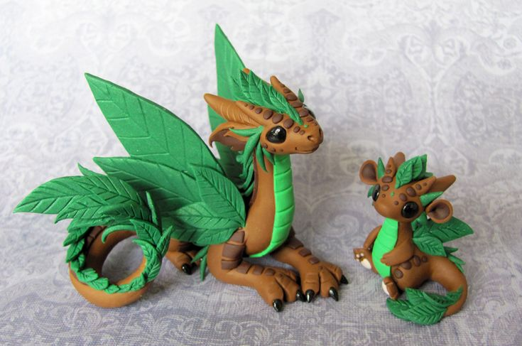 Leaf Dragons by DragonsAndBeasties @ Deviant Art.  I think I'm in love.  *sigh*