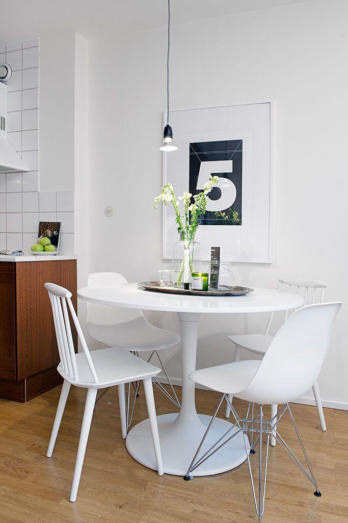 White dining set, timber floors & kitchen