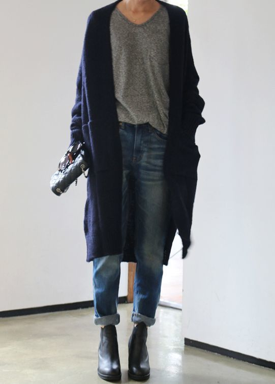 Shop this look on Lookastic: https://lookastic.com/women/looks/open-cardigan-v-neck-t-shirt-boyfriend-jeans/16331   — Navy Open Cardigan  — Grey V-neck T-shirt  — Black Quilted Leather Satchel Bag  — Blue Boyfriend Jeans  — Black Leather Ankle Boots