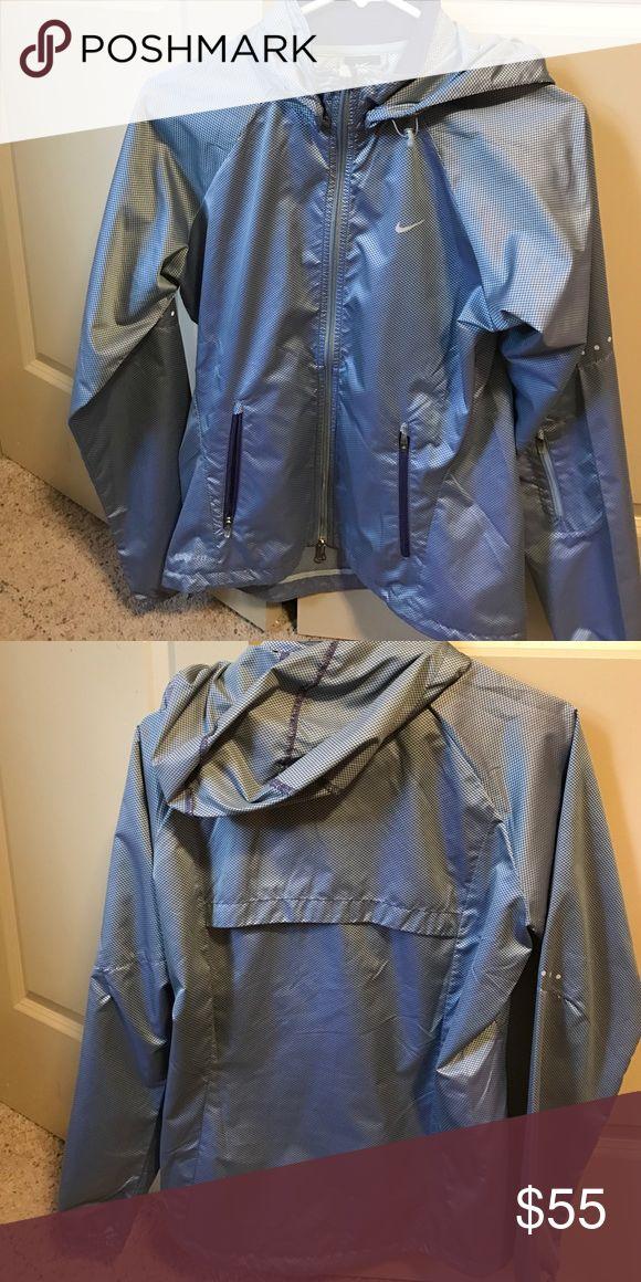 Silver and purple checkered Nike rain jacket Silver and purple checkered Nike rain jacket lightly worn Nike Jackets & Coats