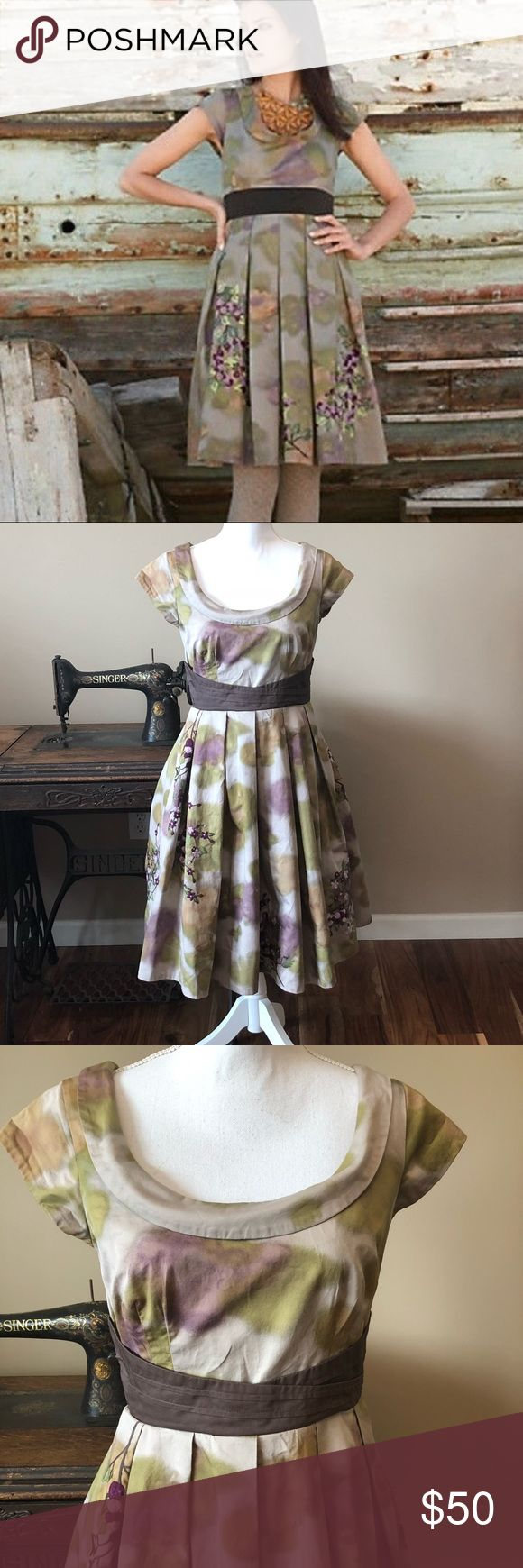 """Anthropologie dress Very good used condition Floreat Anthropologie Trevessia dress.   Stunning water color background with floral embroidery and side zip closure.  Has petticoat underneath.   One hanger strap is broken but doesn't affect appearance or wear of dress.   Size 8 measuring approximately 17"""" armpit to armpit and medium 39"""" in length. Anthropologie Dresses"""