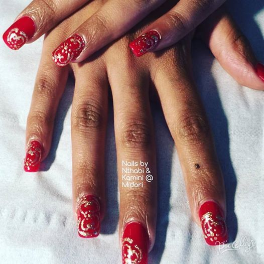 Gorgeous red nails by Nthabi, with henna nail art design by Kamini at Midori!!