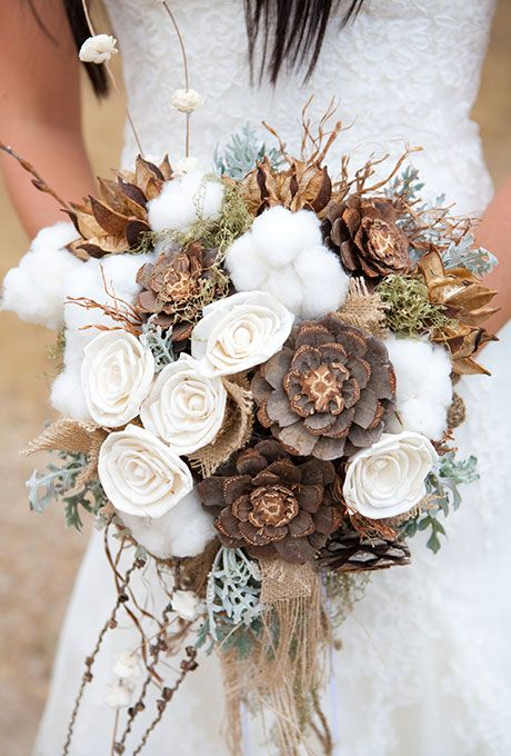 Brides.com: . A rustic bouquet of cotton, pinecones, and dusty miler, accented with pieces of burlap.