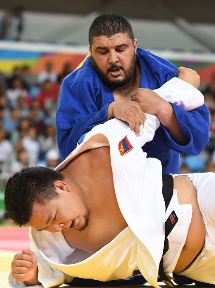 #RIO2016 Mongolia's Temuulen Battulga competes with Algeria's Mohammed Amine Tayeb during their men's 100kg judo contest match of the Rio 2016 Olympic Games...