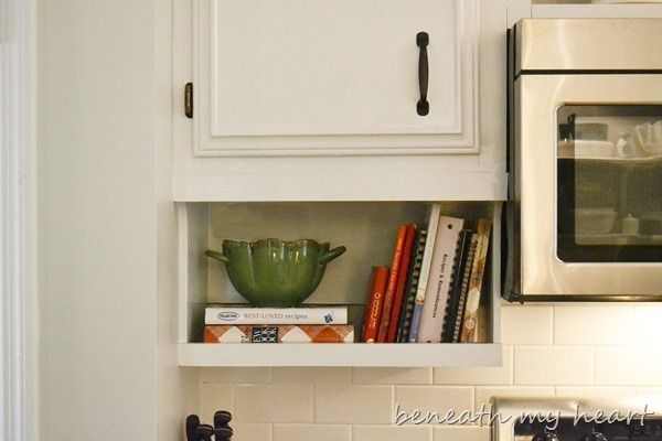 Under-cabinet storage for cook books, spices, etc....only works if cabinets are mounted higher than usual