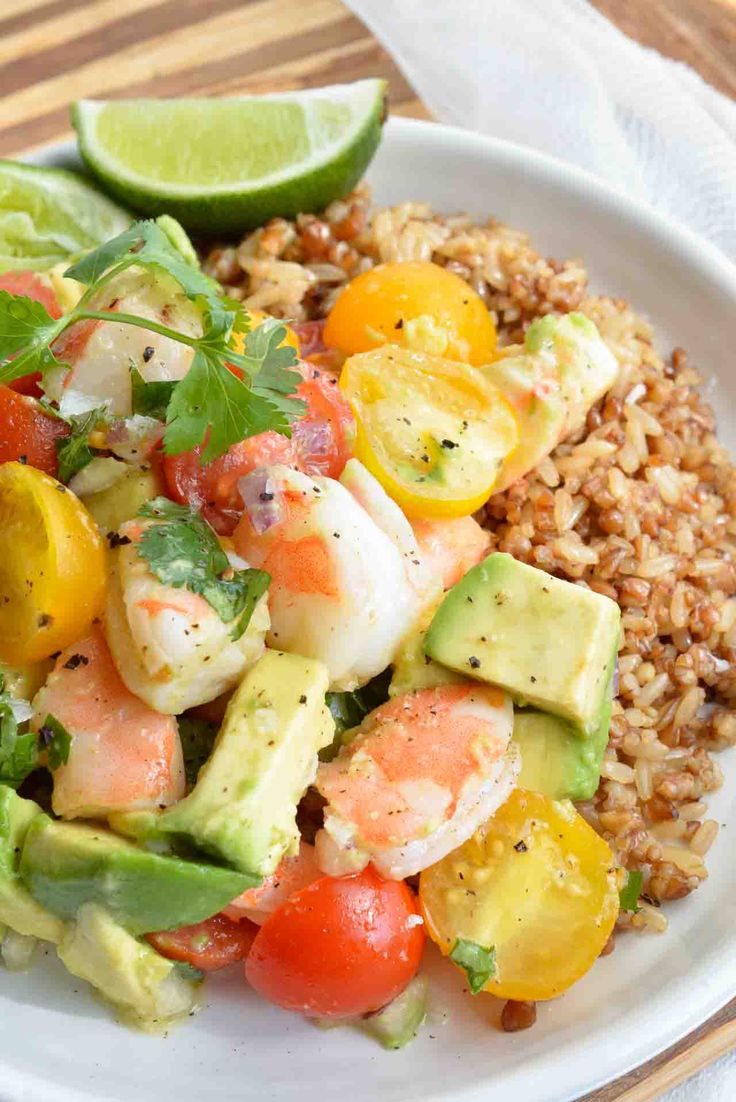 Craving a bright and flavorful meal that is full of fresh ingredients? Make this healthy Avocado and Shrimp Salad Recipe for a nutritious, gluten free and satisfying lunch or dinner! Serve this fresh avocado, tomatoes, lime, cilantro and shrimp on top of rice.