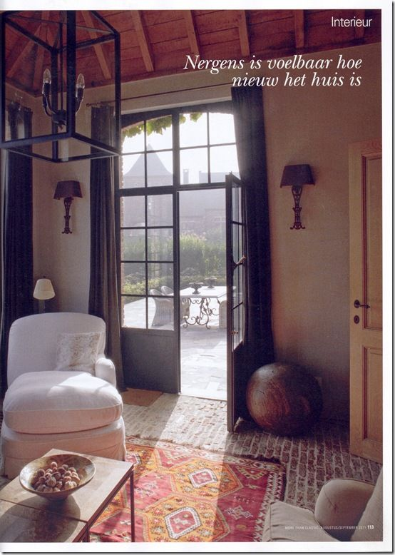 love the neutrals and black touches with the antique colorful rug: Remodel Ideas, Black Doors, Patio Doors, Windows Doors Vaulted Ceilings, Interior Doors, Tile Brick Floors