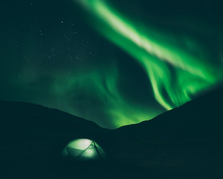 Northern Lights dancing above our tent in the Westfjords /// Iceland ©️ Adam Biernat