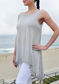 Enjoy this stylish sheer open back top. Perfect to wear over your favorite bandeau top.