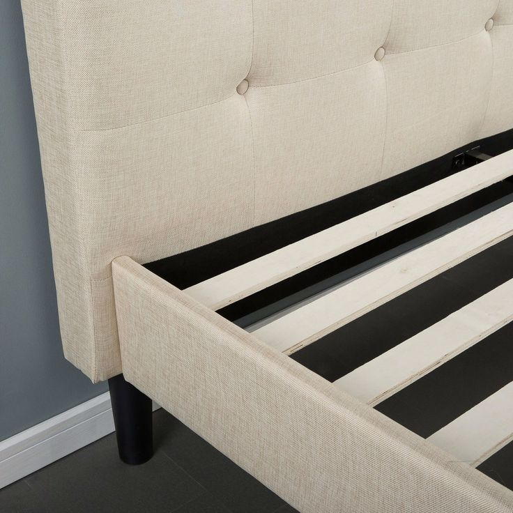 full size platform bed frame with taupe button tufted upholstered headboard