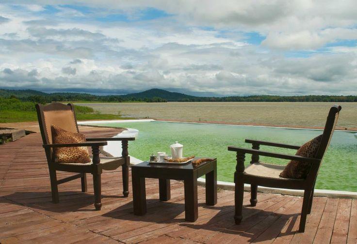 Private poolside tea time at The Bison Resort Kabini, Karnataka, India