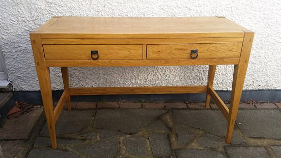 Lovely Willis and Gambier desk/console table. Solid oak Sizes are 120cm long 47cm deep 78cm high. PLEASE ASK FOR A DELIVERY QUOTE AS THE PRICE LISTED IS FOR LOCAL DELIVERY. If you are in the Greenwich or Orpington areas we may be able to deliver for free. We have an outlet in
