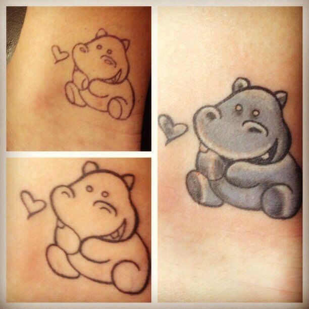 Cute Little Hippo Staring At Heart Shape Tattoo