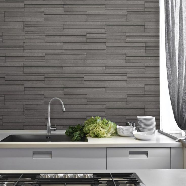Fine Decor Slate Tile Effect Wallpaper -Charcoal Grey FD40126  This striking Slate Tile Effect Wallpaper will make a great feature in any room including kitchens and bathrooms. The design features a realistic slate tiles print in a charcoal grey with a textured finish and shading for added depth. It is printed on to luxury cushioned vinyl paper to ensure durability and a quality finish and will look great when used to decorate a whole room or to create a feature wall. A realistic slate…