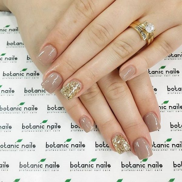 If you want simple yet classy nails then this design is perfect for you, matte nude and gold sparkle nails are the way to go.
