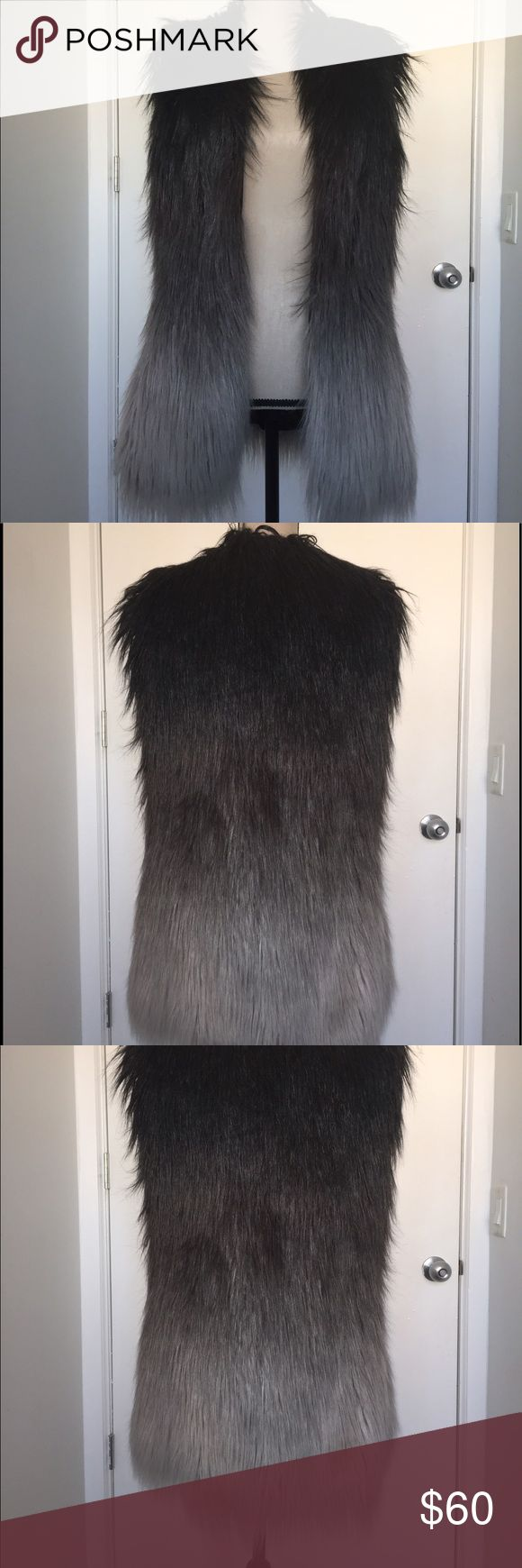 Funky black faux fur ombré vest Never worn. Cool girl vest that will look killer with booties and black skinnies. The fur starts as a dark brown grey and lightens to silver. The fur is long w a slight shine. Size M Fabulous Furs Jackets & Coats Vests
