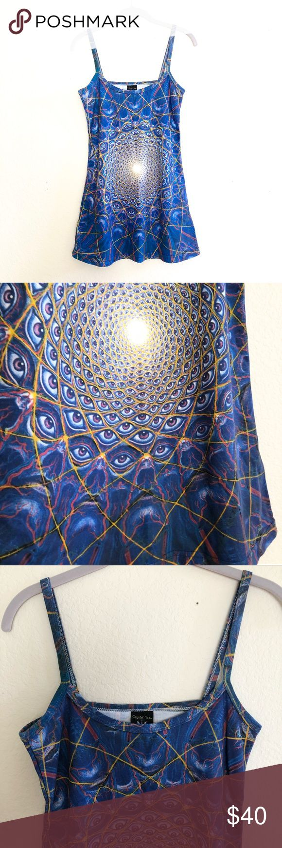 Alex Grey Mini Dress Extremely unique mini dress from artist Alex Grey's Chapel of Sacred Mirrors. Features front and back images of one of his visionary artworks, I forgot the exact one but I will try to find it. I intended on wearing this to a festival but never went or any 😂 amazing spectrum of colors- mainly blue and purple. A really inspiring piece. Great for a festival, or any other psychedelic event. Truly one of a kind piece. I don't really want to let this go 😢. Brand new, never…