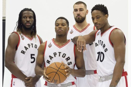 Toronto Raptors, from left to right, DeMarre Carroll, Kyle Lowry, Jonas Valanciunas, and DeMar DeRozan, pose during the Raptors' media day in Toronto on Monday, September 28, 2015.