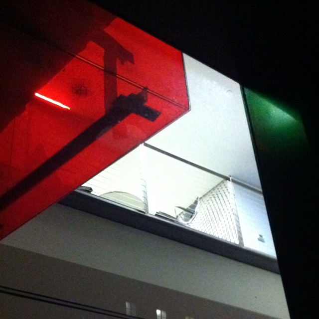 Interior ground-floor contemporary open office space downtown L.A., Gelser. Note transparent red acrylic over hang.