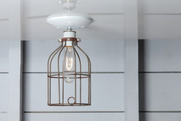 Industrial Ceiling Light - Vintage Rusted Wire Cage Lighting by IndLights on Etsy https://www.etsy.com/listing/180795774/industrial-ceiling-light-vintage-rusted