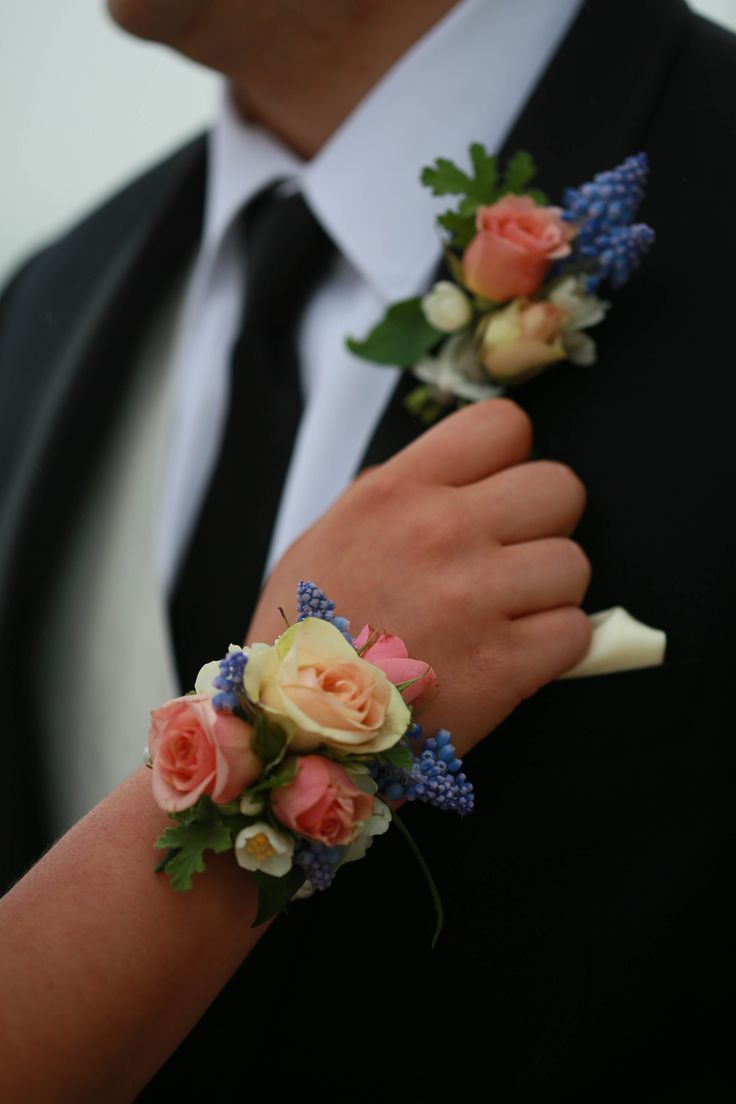 flowers by Laura Of Lauxmont Floral Design peach and pink matching corsage and boutonniere peach pink blue corsage blush and blue flower bracelet prom corsage matching prom boutonniere and corsage