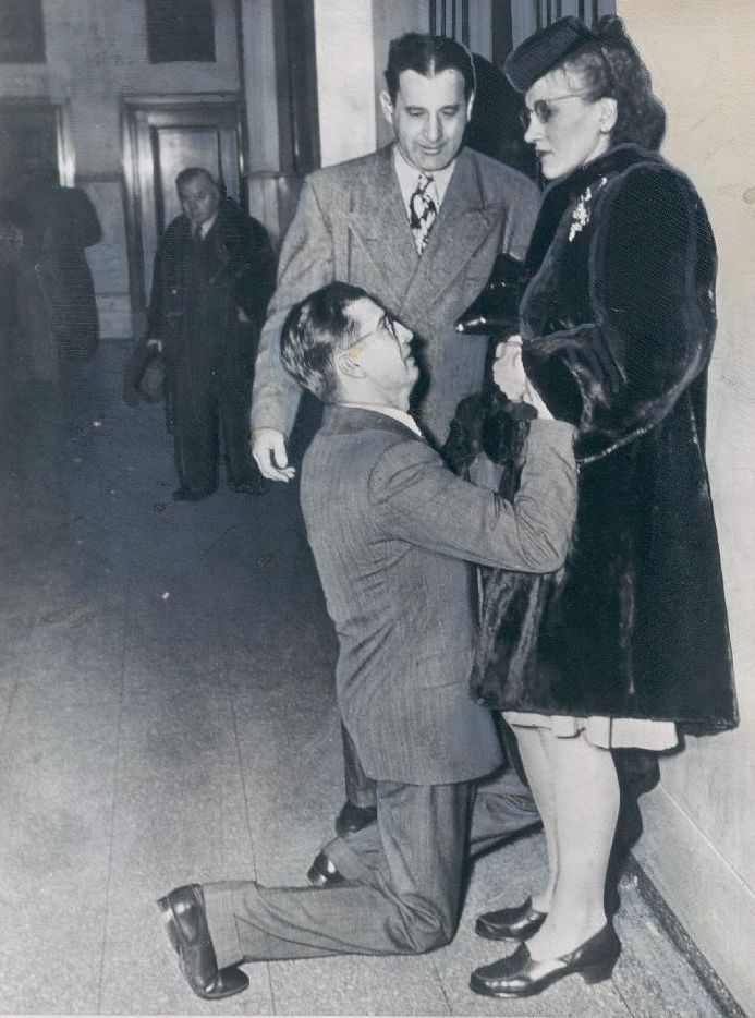 A man begging his wife's forgiveness inside Divorce Court, 1948, Chicago.
