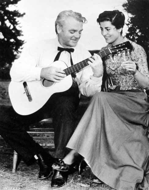 James Cagney strums a guitar for Irene Papas on the Colorado location of Tribute to a Bad Man Tags: 1956, A Musical Moment, guitar, Irene Papas, James Cagney, Tribute to a Bad Man,
