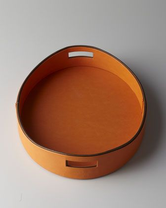 anything hermes orange is welcome in my home.     Orange Faux Leather Tray at Neiman Marcus.