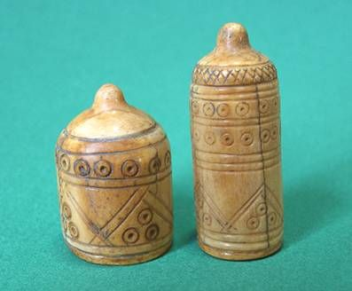 Two Persian chess pieces made of bone, circa 11th century CE. Chess traveled via Silk Road from India to Persia; the Arab world and Europe, and from India to China.
