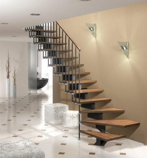 Stilo Open Tread Modular staircase with Dark Beech Treads & Black Steel central spine and balustrade spindles. It is shown here in an L-shape - with a quarter turn at the start of the staircase.