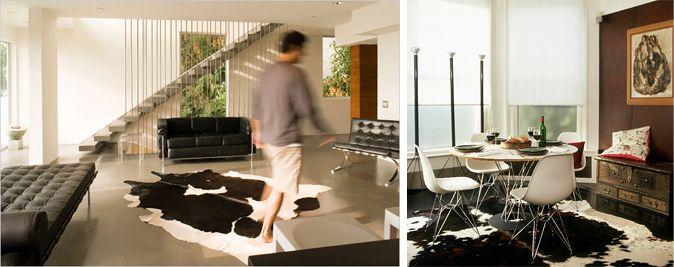 Alfombra animal print combinada con mobiliario de diseño minimalista. http://reformasdediseno.com/trucos-e-ideas-para-decorar-con-una-alfombra-animal-print/
