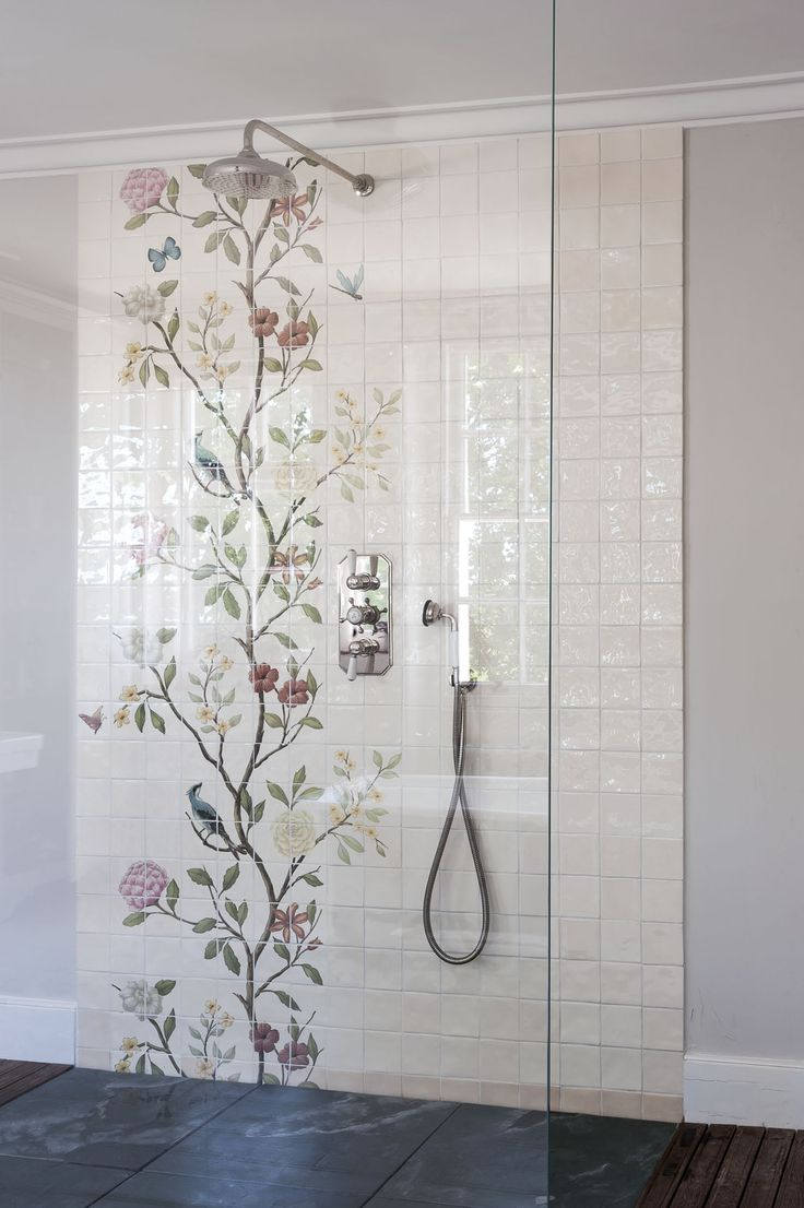This floral tile shower wall mural and slate floor make this open walk in shower inviting and inspiring