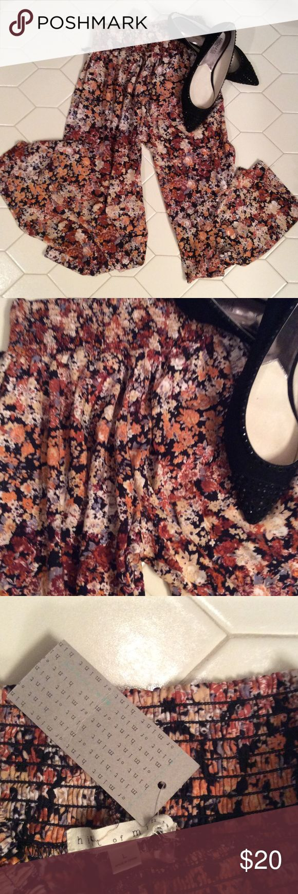 Floral Flowing high waisted pants Floral (cream, tan, black, rust) flowing pants with a high waist several gatherers at the top by Hint of Mint. Great with flats or a neutral espadrille. Size large fits more like a medium. $20   🔶 Please ask all your questions before you purchase. I'm happy😊 to help  🔶 Sorry, no trades or hold. 🔶 Please, no lowball offers. 🔶 Please use the Offer Button 🔶 Bundle for your best prices 🔶 Ships next day, if possible 🎀 Thank you for visiting my closet 🎀…