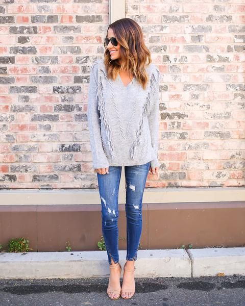 Hello gorgeous! We are loving the fringe accents of our Riva Fringe Sweater in this staple grey hue. This is perfect for the ultra trendy boho babe. The fringe angels towards the center of this cute s